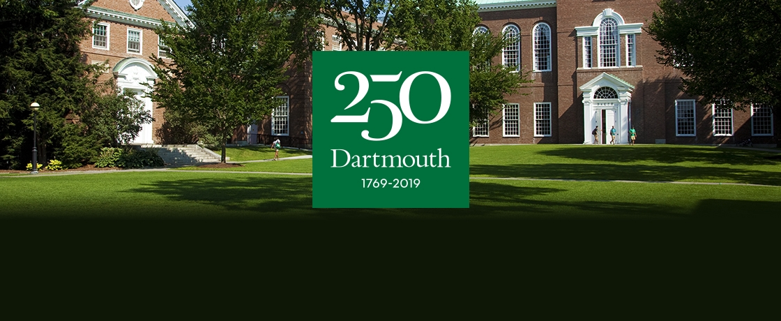 green space in front of baker library with the 250th logo in the middle