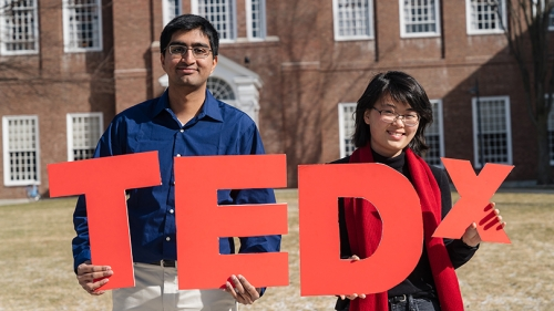 A photo of students holding Tedx letters