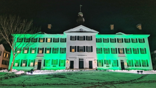 Dartmouth Hall lit green