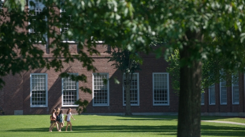 Students walking across the Green