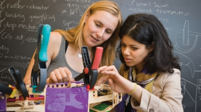 Two female students work together in the lab