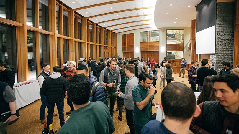 Tuck School of Business students mingle in Raether Hall