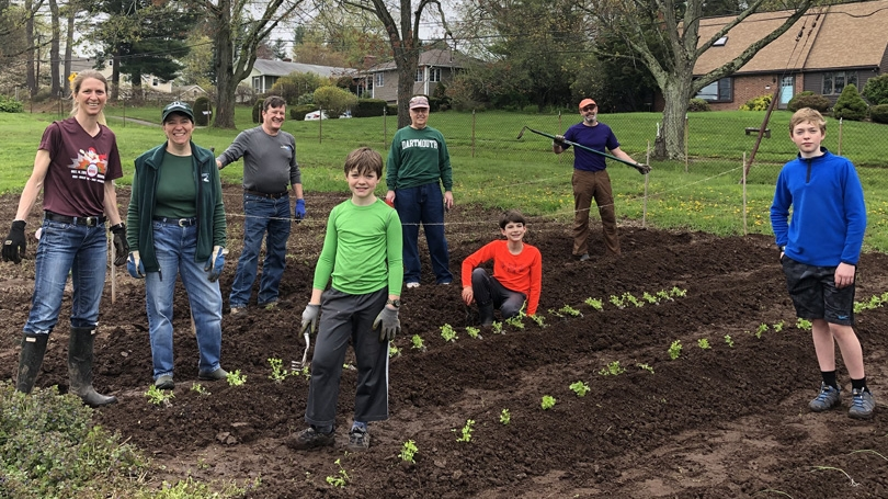 Dartmouth alumni and their families help grow organic vegetables as part of the Plant a Row for the Hungry project in Hartford,