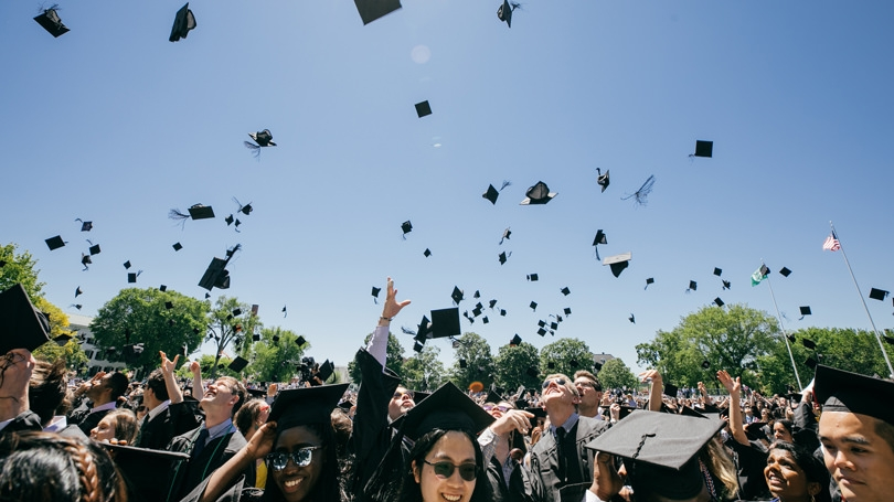 Students throw their caps in the air at the end of the 2019 commencement ceremony
