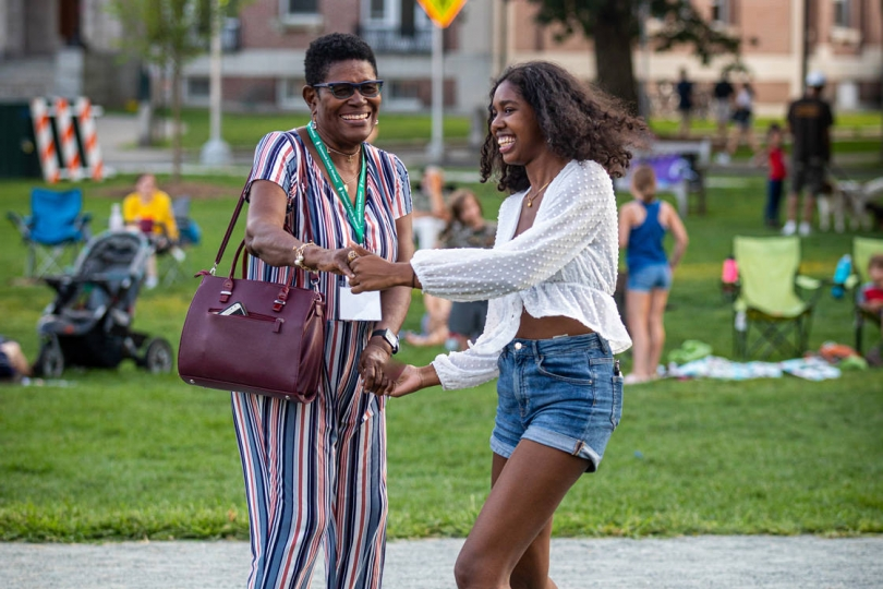 Members of the evening concert crowd dance on the Green. Sophomore students and their families, in town for Dartmouth Family Weekend, were welcome to join in the community celebration. (Photo by Lars Blackmore)