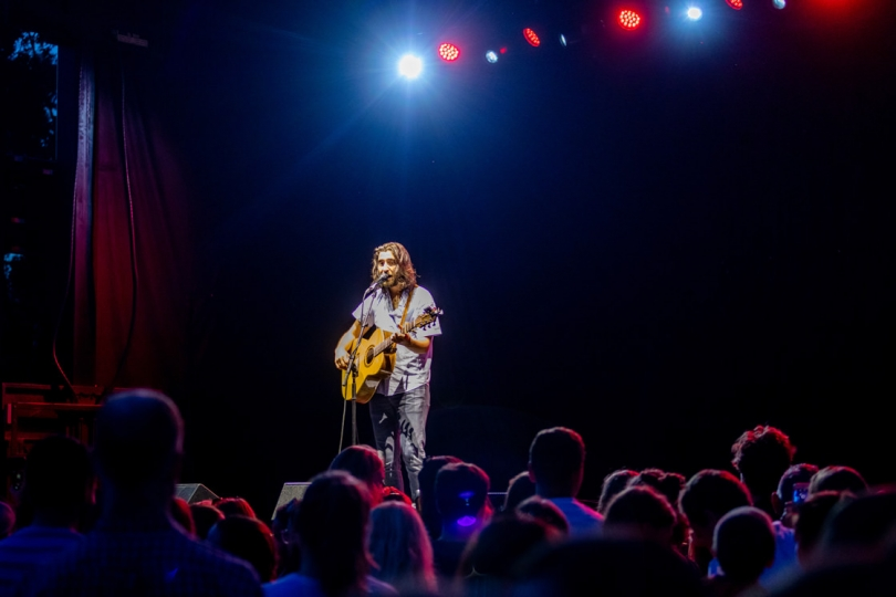 Noah Kahan, a singer-songwriter from Strafford, Vt., performs for a fan-filled crowd during the final set of the evening. (Photo by Lars Blackmore)