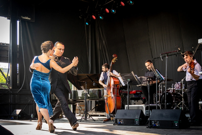 Andrés Bravo and Sarita Apel, professional tango dancers based in New York City, perform with the Pedro Giraudo Tango Quartet to kick off the free evening concert program. (Photo by Lars Blackmore)